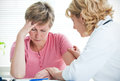 Bad news mid adult women talking to doctor about her diagnosis Stock Photos