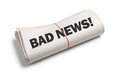 Bad news newspaper roll with white background Royalty Free Stock Photos