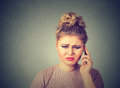 Bad news. Portrait unhappy woman talking on mobile phone looking down Royalty Free Stock Photo