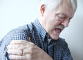 Bad pain in shoulder of senior man older with his Royalty Free Stock Photography