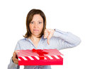 Bad present thumbs down closeup portrait of woman holding gift in one hand with other displeased with what she received isolated Stock Images