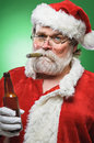 Bad santa with a beer and cigar smoking drinking Stock Images