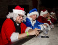 Bad santa claus several men in costume suits drinking at a bar Stock Image