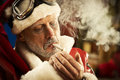 Bad santa smoking a joint portrait of Stock Photo