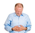 Bad stomach ache closeup portrait old business man elderly executive boss corporate worker retired guy unhealthy grandfather Royalty Free Stock Images