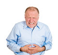 Bad stomach ache closeup portrait old business man elderly executive boss corporate worker retired guy unhealthy grandfather Stock Photo
