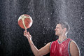 During bad weather basketball player is practicing preparing himself for a big match while big rain is falling Stock Image