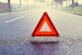 Bad Weather Driving - Warning Triangle on a Misty Road Royalty Free Stock Photo