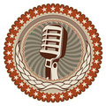 Badge with old microphone. Royalty Free Stock Photo