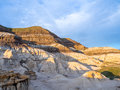 Badlands drumheller bathed in the warm light of a summer sunset near in alberta canada Stock Photography