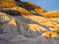 Badlands drumheller bathed in the warm light of a summer sunset near in alberta canada Stock Photo