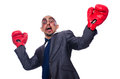 Badly beaten businessman with boxing gloves Stock Photo