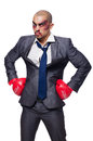 Badly beaten businessman with boxing gloves Stock Photos