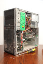 Badly maintained computer pc image shows a or that has had the side panel removed suggesting it maybe being serviced it is Stock Photography
