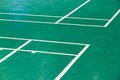 Badminton court close up corner of old and dirty green color with white line Stock Image