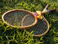 Badminton equipment rackets and shuttlecock in the grass Royalty Free Stock Photo