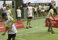Badminton junior athlete practicing in coaching clinic with international athlete in solo central java indonesia Royalty Free Stock Image
