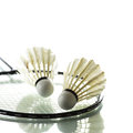 Badminton rackets and shuttlecocks isolated on white Stock Images
