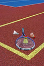 Badminton shuttlecocks racket colored and placed in the corner of a synthetic field Royalty Free Stock Photography