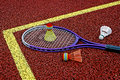 Badminton shuttlecocks racket colored and placed in the corner of a synthetic field Stock Images