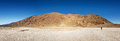 Badwater panorama a solitary person walks out on the salt pans of basin in death valley california usa Stock Photography