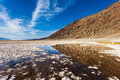 Badwater pond with reflections mountain n a at basin in death valley california Stock Photos