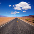 Badwater road death valley national park california straight in desert to mountains Royalty Free Stock Photography