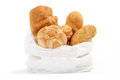 Bag of bread on a white table background Royalty Free Stock Images