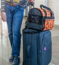 Bag for cats and a teenager& x27;s legs at the train station. Travel with an animal Royalty Free Stock Photo
