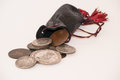 Bag of money small black with antique coins Royalty Free Stock Image