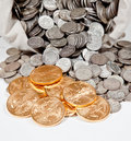 Bag of silver and gold coins Stock Photos