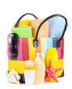 Bag with towels, sunglasses and beach items Royalty Free Stock Photo