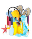 Bag with towels, sunglasses, flip-flops and beach items Royalty Free Stock Photo