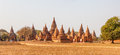 Bagan panorama in temples and stupas with a field in a front Stock Image