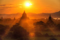Bagan temples at sunset panorama of many and rice fields burma Royalty Free Stock Photography