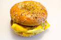 Bagel breakfast sandwich an everything with scrambled egg cheddar cheese and sausage Royalty Free Stock Images
