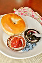 Bagel with jelly and blueberries a variety of jellies Royalty Free Stock Image