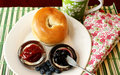 Bagel with jelly and blueberries a variety of jellies Stock Image