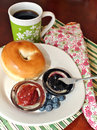 Bagel with jelly and coffee a variety of jellies a cup of Royalty Free Stock Photos