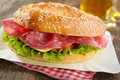 Bagel sandwich with sausage cheese and lettuce Royalty Free Stock Image