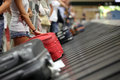 Baggage claim at airport suitcase on luggage conveyor belt in the Royalty Free Stock Photo