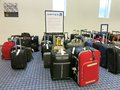 Baggage laid out at airline luggage counter after flight delayed many flights have been delayed in winter causing luggage to g Royalty Free Stock Photos