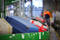 Baggage sorting on conveyor belt at the airport selective focus Stock Photos