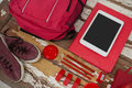 Bagpack, shoes, digital tablet and stationary Royalty Free Stock Photo