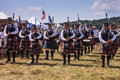 Bagpipe players and drummers at the scottish games in the plains virginia several clans of paraded through the grounds of the Stock Photos