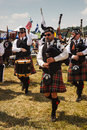 Bagpipe players and drummers at the scottish games in the plains virginia several clans of paraded through the grounds of the Royalty Free Stock Photo