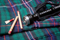 Bagpipe reeds on tartan Royalty Free Stock Image