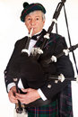 Bagpiper in tartan Stock Photo