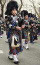 Bagpipers of Nassau Police Pipes and Drums marching at the St. Patrick's Day Parade Royalty Free Stock Photo