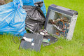 Bags with garbage plastic on the green grass Stock Photography